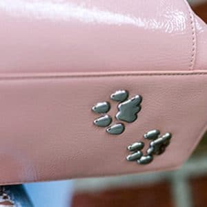 Designer creates a paw accent to protect and distinguish totes and handbags